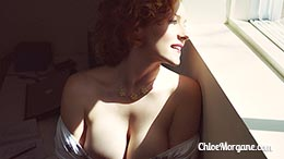 Chloe Morgane in Redhead Pinup by the Window